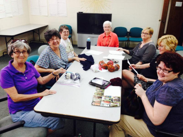 Members of Knots of Love meet to handcraft items for others in need.